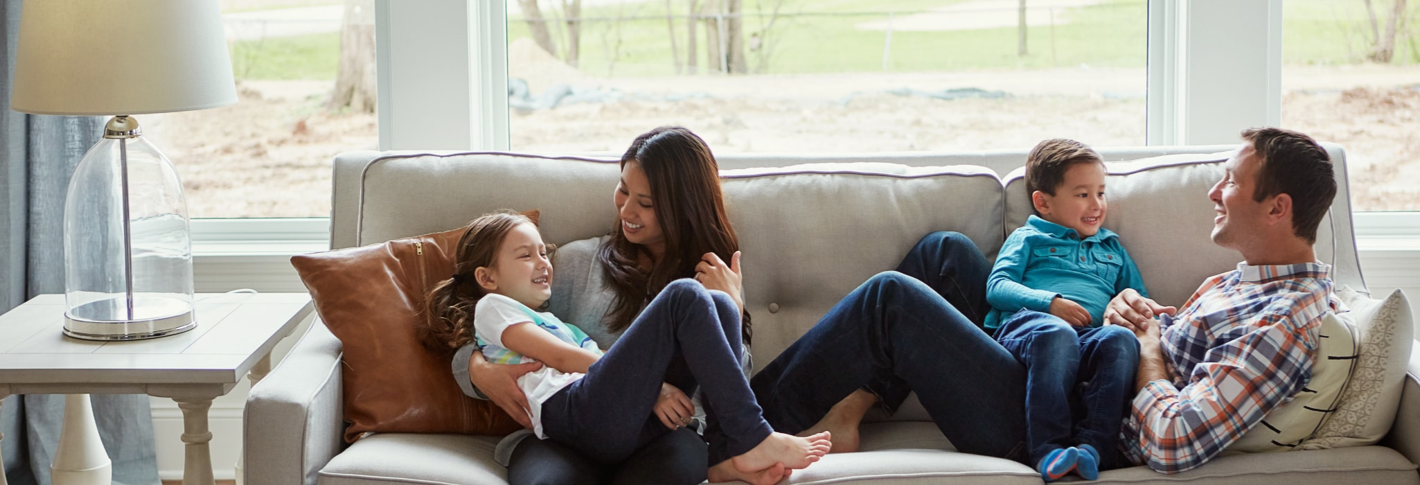 Family on couch in comfortable warm house